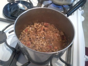 Peas simmering--Note the bacon!